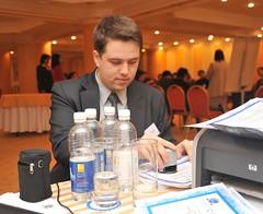 Alexandr Dimitriev stamping certificates, Regional Advocacy Training, Almaty, Kazakhstan, January 16, 2009 (Ivan S. Abrams) Tags: nikon ivan s tajikistan lawyers nikkor abrams uzbekistan centralasia kyrgyzstan nikondigital sovietunion ussr smrgsbord turkmenistan advocates exussr kazakshtan onlythebestare abaroli ivansabrams trainplanepro nikond700 safyan nikon24120mmf3556gvr ivanabrams abramsivan copyrightivansafyanabrams2009allrightsreservedunauthorizeduseprohibitedbylawpropertyofivansafyanabrams unauthorizeduseconstitutestheft thisphotographwasmadebyivansafyanabramswhoretainsallrightstheretoc2009ivansafyanabrams nikkor24120mmf35mmf3556gvr abramsandmcdanielinternationallawandeconomicdiplomacy ivansabramsarizonaattorney ivansabramsbauniversityofpittsburghjduniversityofpittsburghllmuniversityofarizonainternationallawyer