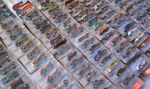 Hot Wheels for sale...on a bed...in a hotel room