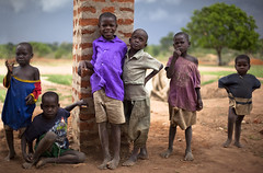 the usual suspects (Andy Kennelly) Tags: africa trees children colorful bricks pillar expressions usual dirt uganda suspects pillisa facesofuganda