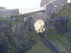 Dunluce Castle County Antrim Ireland (seanfderry-studenna) Tags: ocean county ireland windows sea sky irish tower castle history tourism stone clouds photography coast model ancient ruins waves doors turquoise teal military north navy indigo royal medieval eire cliffs historic atlantic norman northernireland walls ultramarine fortification fortress atlanticocean invasion defence touristattraction bluegreen beryl sapphire ulster cobalt normans medievel countyantrim antrim cerulean northcoast antrimcoast clifftop celts bluegray irishsea dunluce dunlucecastle eireann ninaficurfeenan ninaficur