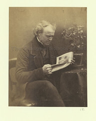 DB_183 (TGSE01014) Duncan Brown reading (Glasgow School of Art Archives & Library) Tags: flowers portrait bw plants brown white selfportrait man black male leaves reading scotland leaf chairs britain glasgow 19thcentury books indoors figure tables seated gentleman duncanbrown