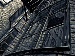 Through the Looking-Glass (gothicburg) Tags: reflection brick window lamp göteborg backyard sweden gothenburg diagonal sverige lightroom magicrealism vasastan olympusc5050z darkestdreaming daskabinett 080701 moodyspooky storgatan25
