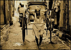 Story of the Rickshaw Puller | Kolkata (A y A n) Tags: life road street horse india west work canon published transport story human tired commute worker 1855 rickshaw stress porter fatigue kolkata bengal calcutta ei strain puller bengali ayan alka bihar antara toil kavitha krishnamurthy nandy nohoi bondhu 400d jibon aplusphoto xuna yagnik khasnabis