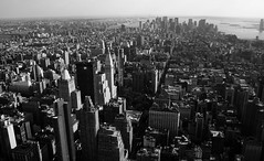 Manhattan Island (chrissuderman) Tags: city nyc newyorkcity blackandwhite bw usa newyork skyscraper buildings river island cityscape view manhattan grayscale manhattanisland