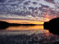 The Descent (Creepella Gruesome) Tags: sunset sky lake nature clouds reflections silhouettes