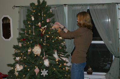 Tammy decorating tree