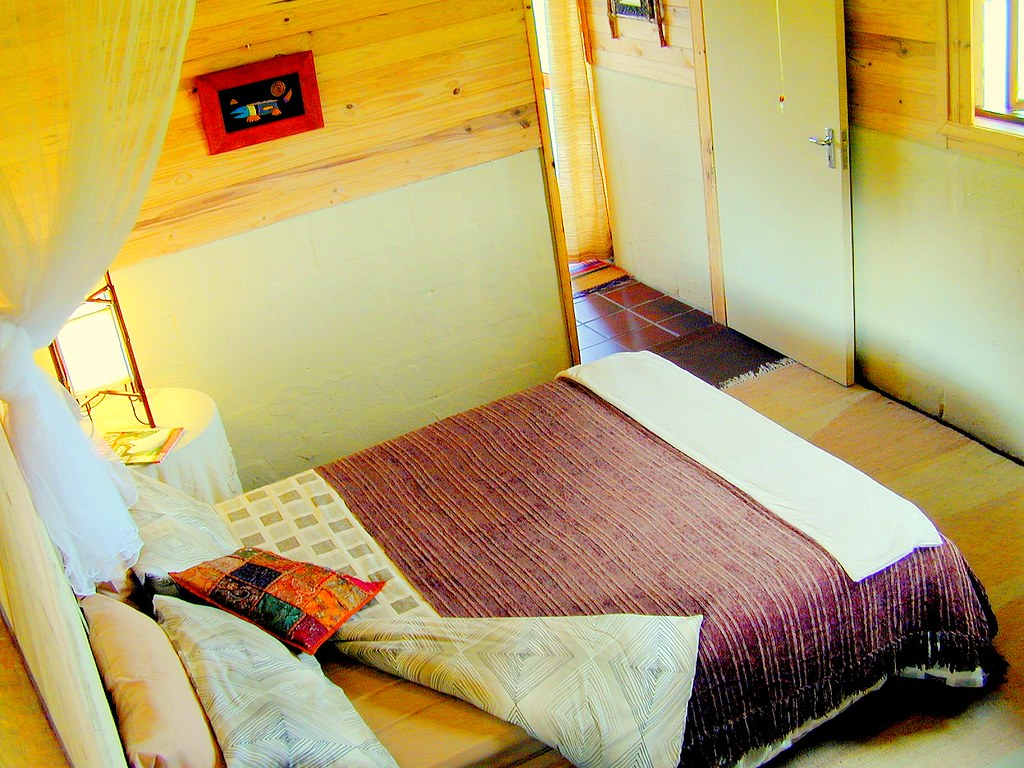 peace of eden accommodation - marimba cabin bedroom