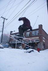 skier jumping (woodindian) Tags: seattle city urban snow ski streets snowboarding boards day skiing snowy board hill ballard sled blizzard jumps sleds sleding phinney