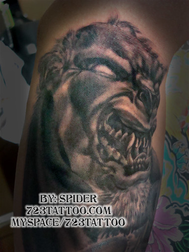 werewolf tattoo, adapted from a clay sculpture, freehand, on the upper arm