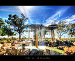 Fountain of Renmark, South Australia :: HDR (:: Artie | Photography ::) Tags: park sky sunlight water fountain metal clouds photoshop canon flow pond bravo rocks cs2 australia wideangle lensflare handheld 1020mm southaustralia hdr happynewyear artie 3xp sigmalens photomatix tonemapping renmark tonemap 400d rebelxti fountainofrenmark