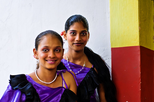 In Goa at Bonderam, Two Girls smile and wait for their turn to dance !