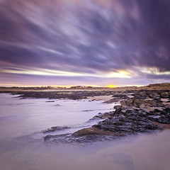 Embo Sunset (Stuart Stevenson) Tags: longexposure blue sunset sea seascape motion seaweed beach wet water yellow canon landscape evening scotland movement rocks waves purple dusk tide scottish swell dornoch embo subdued softcolour goldensand northeasthighlands canon5dmkii scuddingclouds stuartstevenson ecoss