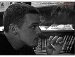 74/365 - Stranger 26/50 - Derrick (MyronLArmour Photography) Tags: portrait blackandwhite bw apple oneaday canon eos book blackwhite orlando aperture dof florida availablelight cigarette smoke profile stranger bookshelf photoaday 7d 365 day73 polite pictureaday cigarboxes quantaraylens 2890mm project365 project36573 50strangers project36509jun11 project365060911 strangerderrick myronarmourphotography
