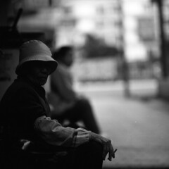 in a few moments (memetic) Tags: street bw woman 120 6x6 hat mediumformat asian hongkong blackwhite break tl cigarette chinese smoking hp5 smoker ilford p6 pentaconsix sonnar shamshuipo 180mm