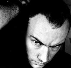(PiggBox.) Tags: portrait blackandwhite hairy white man black male 120 6x6 film blanco newcastle arm good mark retrato negro evil scottish newcastleunited chico toon nufc notdigital hombre balding lookalike goodandevil twofaces alanshearer portraitofaphotographer