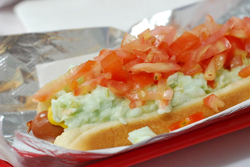coleslaw dog with tomato and mustard