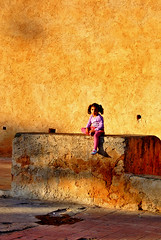 The yellow wall (jendayee) Tags: sunlight girl beautiful yellow wall kid child textures maroc ih artisticexpression mywinners anawesomeshot colorphotoaward diamondclassphotographer flickrdiamond colourartaward thebestyellow
