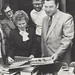 Barbara Cook and John Stowell (left background) looking over some German books with two unidentified gentlemen, the University of Newcastle, Australia