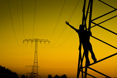 Reach out! Feel the Moment! (Crazy Ivory) Tags: light boy sea sky selfportrait man black color berlin guy art industry public colors field silhouette yellow backlight night canon contraluz dark freedom evening abend climb crazy amazing interesting heaven industrial day darkness adult bright reaching nacht bokeh tag free structure climbing powerlines frame electricity mann reach unusual silueta persons dslr 70300mm tamron brandenburg junge gegenlicht reachingout reachout berlinatnight tamron70300 ahrensfelde tamron70300mm lastdaysofsummer youngguy supershot 400d abigfave canoneos400d visiongroup toisndeoro gettygermanyq2 gettygermanyq3 gettygermanyq4