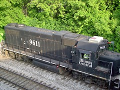 A former Iliinois Central EMD roadswitcher at work shoving a cut of tank cars. Glen Yard. Chicago Illinois. May 2007.