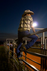 Mamas Don't Let Your Babies Grow Up to Be Cowboys (WilliamBullimore) Tags: man male hat night fence belt cowboy nightshot country fences australia arena jeans queensland rodeo outback fencing muster stance ingham jackaroo digitalcameraclub canonef28105mmf3545usm platinumphoto colorphotoaward inghamrodeo atomicaward
