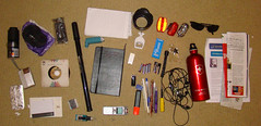 What's in my bag (Cian Ginty) Tags: camera moleskine sunglasses bicycle bag lights bottle pump headphones pens mybag whatsinmybag notepad voicerecorder bicyclelights reportersnotepad