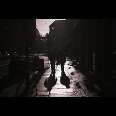 Two shadows (manganite) Tags: street shadow red people urban bw white black berlin men topf25 silhouette contrast digital germany walking geotagged high nikon women europe shadows dof tl framed candid perspective silhouettes streetscene stranger d200 nikkor dslr toned mitte 18200mmf3556 utatafeature manganite nikonstunninggallery date:month=december repost1 date:year=2008 rosenthalerstrase date:day=28 geo:lat=5252459 geo:lon=13402982 format:ratio=32 repost2 stadtgetty2010