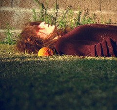 we lie awake and we dream of making our escape (self spirit soul) Tags: red orange selfportrait green girl grass horizontal fruit hair death sweater lie recline keepbreathing
