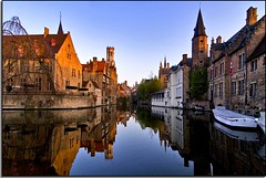 A Morning of Reflection In Bruges (Nathan Bergeron Photography) Tags: architecture sunrise reflections geotagged boats canal interestingness europe view belgium brugge medieval canals belltower unesco worldheritagesite belfry bruges belfort oldworld westflanders rozenhoedkaai supershot explored flemishregion yearinfrance belfryofbruges riverdijver geo:lat=51207468 geo:lon=3227738
