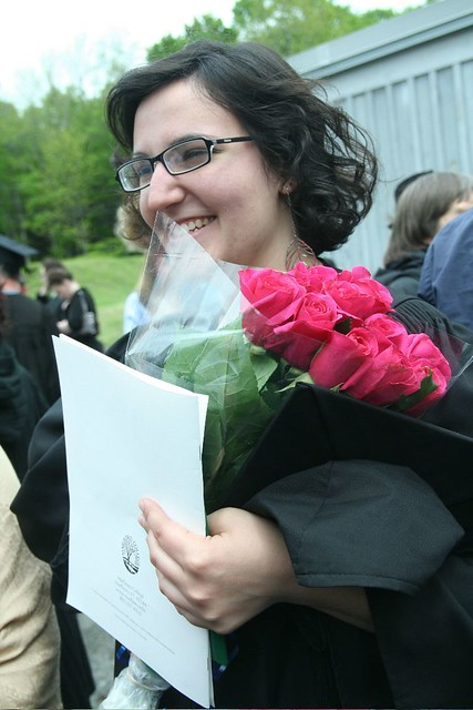 Grad with Program and Flowers
