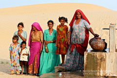 Parched throats, happy smiles   Water fount in the Thar desert of Rajasthan (marcusfornell) Tags: poverty life india water rural children women asia asien desert marcus south tribal nomad pokhara indien jaipur bikaner jaisalmer rajasthan udaipur jodhpur poorness indigence phalodi fornell rajasthanthecolourstate theindiatree palodhi