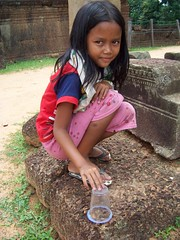 Catching Grasshoppers (BaronessEast) Tags: children ancient ruins cambodia buddha kingdom temples siem reap landmines angkor wat