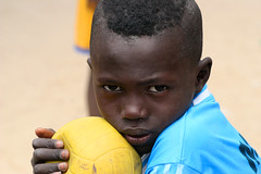 A portrait of a boy with a soccer ball. (cookiesound) Tags: life africa trip travel boy summer vacation portrait holiday playing travelling face childhood closeup kids portraits canon ball children photography football kid eyes reisen colours fotografie leute child soccer urlaub canoneos20d afrika senegal canoneos soccerball poeple reise facialexpression travelphotography traveldiary capskirring travelphotos reisefotografie faceexpression soccerworldcup facecloseup footballafrica flickrsfinest reisetagebuch kidsplayingfootball portraitofpeople reisebericht kidsplayingsoccer childrenplayingfootball portraitworld travellifestyle cookiesound nisamaier soccerinafrica ulrikemaier childrenplayingsoccer kidandsoccerball soccersenegal footballsenegal childwithfootsball