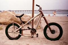 Custom Ride (Brian Auer) Tags: ocean california color film beach bike bicycle outside 50mm diy sand rust ride unitedstates pacific cloudy outdoor naturallight oceanbeach custom locked tethered chained asa100 konicaminolta negativecolorfilm minoltasrtsuper 135format vx100s
