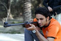 صدّ عني ترى عينك سهمها خطير (aZ-Saudi) Tags: red orange black color green bird hit friend gun watch arabic saudi arabia ksa alhasa arabin ِarabs