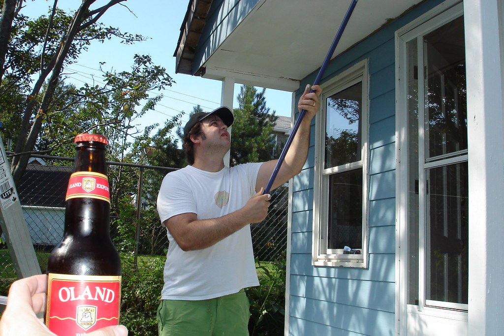 Andrew painting the trim on the shed