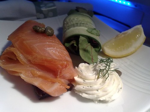 Smoked Salmon in Vodka with Red Onion, Capers, and a Dill Cream Cheese with Cucumber Roll and Mesclun Salad