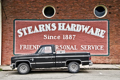 Stearn's Hardware (Curtis Gregory Perry) Tags: red usa brick chevrolet oregon america truck oakland us hardware store pacific northwest united pickup chevy pacificnorthwest states silverado portholes stearns