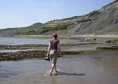 Paddling (Phantom_snapper) Tags: ocean uk blue sea vacation england sky cliff sun holiday seaweed english beach water rock fossil coast sand weed shoes rocks britain tide paddle sunny lizzie splash paddling rockpool charmouth jurasic