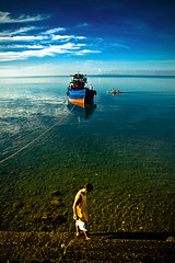 A Contrast of Early Morning Colors (jeridaking) Tags: city morning blue sea sky people sun distortion beach public clouds sunrise landscape boats early cool asia southeastasia shadows market stones horizon philippines warmth calm seawall cast serene seashore ralph visayas banka leyte ormoc bisaya bisdak ormocanon jeridaking matres fortheloveofphotography leytephotographer ormocphotographer