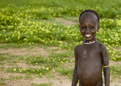 How do you say Cheeese in Karo? Ethiopia (Eric Lafforgue) Tags: flowers smile fleurs kid artistic dam tribal ornament bodypainting tribe rite sourire barrage tribo adornment pigments tribu omo eastafrica thiopien etiopia ethiopie etiopa 5330 lafforgue  etiopija ethiopi  etiopien etipia  etiyopya  nomadicpeople    korcho   salinicostruttori    gibeiiidam gibe3dam bienvenuedansmatribu peoplesoftheomovalley