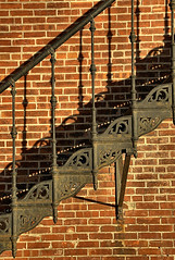 Iron Shadows (FotoEdge) Tags: 1920s sunlight brick coffee leather stone museum liberty 1930s ancient shoes shadows sundown flag details small memories broadway rusty americanflag polish funky wafflehouse staircase american tiny directions eggs glowing artdeco syrup wpa arrow mace symbols storefronts dye pecan deco waffles soles obama hashbrowns cracked ourtown relics timeless stucco awnings compact townsquare 3littlepigs ironworks craftsmanship hallofwaters brickhouse excelsiorsprings tileroof lifts bonehead tilework heals stonecottage excelsiorinstitute gallery105 excelsiorspringshistorical solidlikearock decoview ironshadows