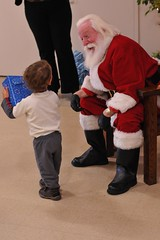Isaiah thanks Santa for his gift