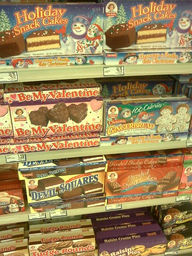 Valentine cakes surrounded by Christmas cakes at the grocery store