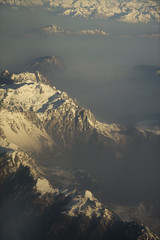 One fly over the Alps (andreea_gerendy) Tags: morning winter italy snow mountains alps clouds italia sunny fromtheplane valleys novideo canoneos400d andreeagerendy overthemountains