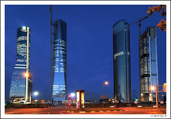 Cuatro Torres Business Area. Hello and see you soon... Spain! (B'Rob) Tags: madrid blue light sunset sky españa streetart tower art luz true azul night four cuatro photography noche photo yahoo google twilight spain nikon flickr paradise torre crystal crane space picture caja best explore cielo wikipedia eden crepusculo grua cristal paraiso espacio d300 ctba vallehermoso 18200mm d40 brob explored sacyr gettyimagesspainq1 brobphoto