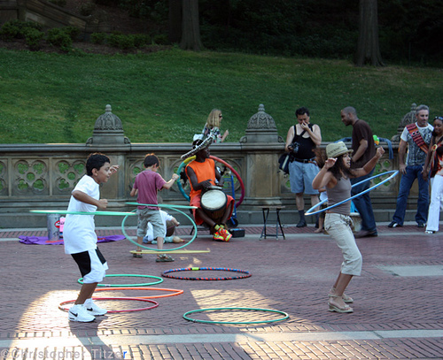 a diverse crowd enjoying Central Park, NYC (by: Christopher Titzer, creative commons license)