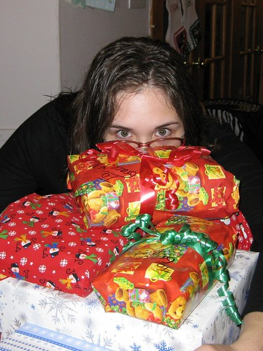 Grace peeks over presents