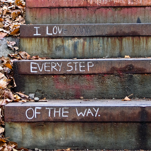 graffiti on stairs: I love you / every step / of the way