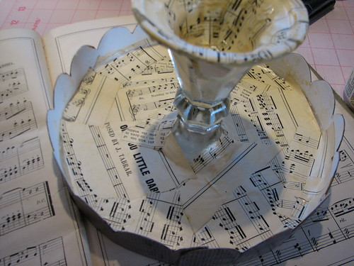 decoupage the sheet music in small pieces